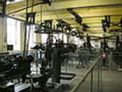 Machines in motive power room with power relay system on ceiling in Bradford Industrial Museum, author Linda Spashett